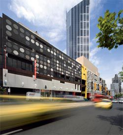 Looking west along Latrobe Street with the existing walls covered in spots.