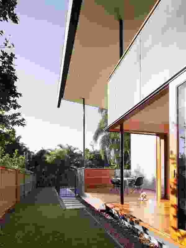 The rear extension is a series of generous platforms that hover just above ground level.