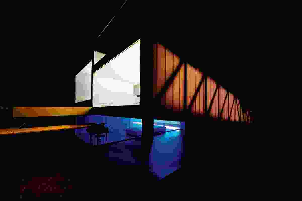 Semitranslucent polycarbonate walls wrap around the structure, creating a lantern effect at night.