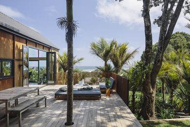 The ample deck with sea views features furniture by BoConcept and pieces purchased or commissioned by the homeowners.