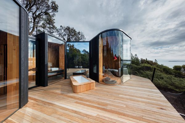 The living and sleeping arms of each pod embrace a private deck, providing shelter and privacy.