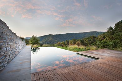 Low-level textural plantings and the reflective surface of the infinity pool enhance the outstanding borrowed views at Halls Ridge, Carmel Valley, California.