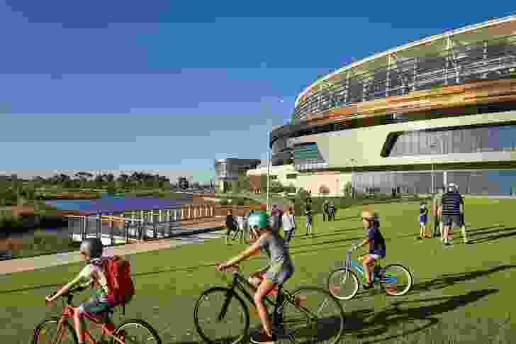 A network of walking and cycling trails weaves through the site, providing connections to the river and CBD.