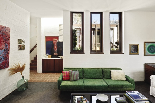 The cosy, carpeted sitting room of the Cater house features three vertical slot windows that look back into the courtyard.