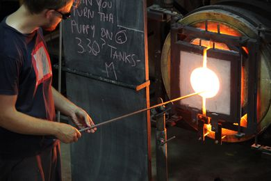 In the Glass Studio, the molten form goes back into the furnace.