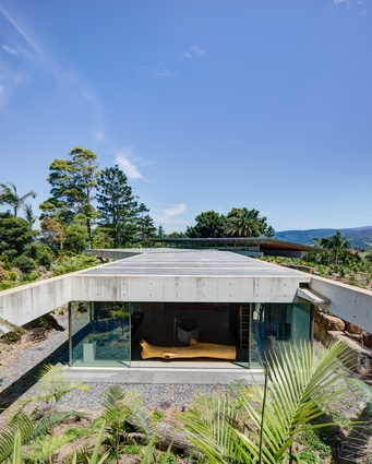The private pavilion is anchored into the ground via a continuous sequence of concrete roof ribs and legs.