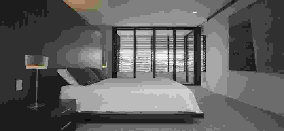 The bedrooms open onto louvre-edged verandahs that overlook the street.