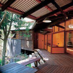 The Taringa House. The living room bay window, the bathroom and the landing seen from the verandah.