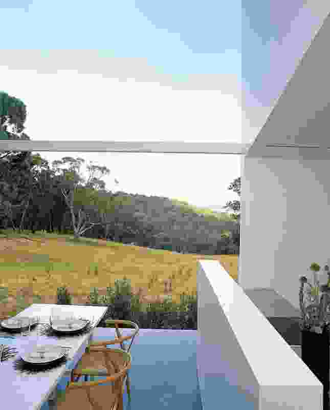 The house is sited in a clearing in the bush, capturing a gun-barrel view to the dam and landscape.