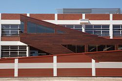 The stairwell extension gives a new form and texture to the back of the existing building.