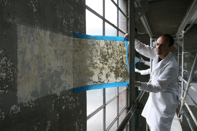 Jorge Otero-Pailos cleans the wall of the Alumix factory in 2008.