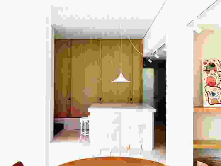 The kitchen is now also the entry hall, a hub around which all circulation flows.