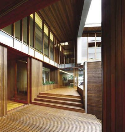 The building is shaped by a strong envelope of zinc lined with timber reveals.