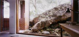 Sandstone boulder framed by the library window.Image: Richard Glover
