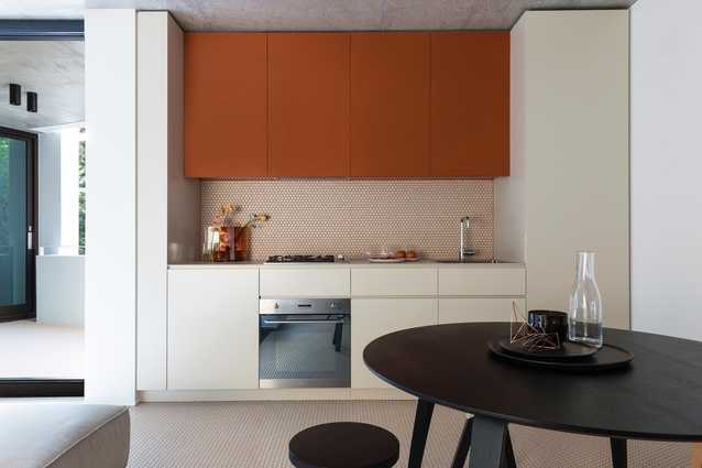 Within each unit the tile grout and joinery has been colour matched. A burnt sienna colour palette has been used in the two-bedroom first-floor apartment.