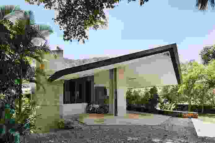 Triangular volumes form the basis of the plan, and the shape is repeated throughout the interior and exterior.