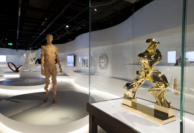 Out of Hand: Materialising the Digital installed at the Powerhouse Museum. Works shown: Untitled #5 by Richard Dupont (left) and Perfect Forms by Barry X Ball (right).