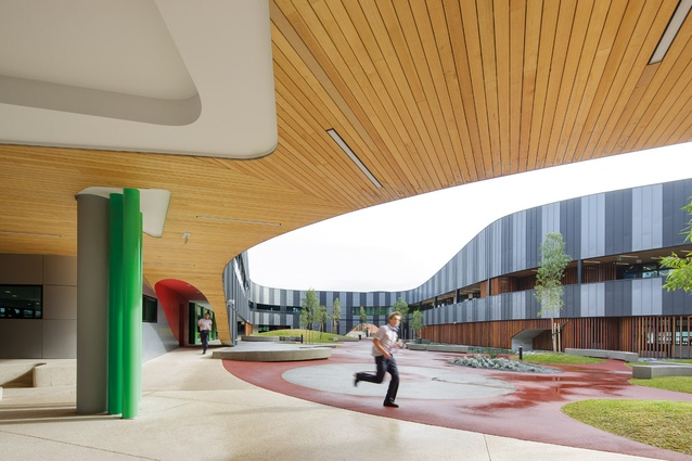 A timber-strutted breezeway opens to a central courtyard designed by Oculus.