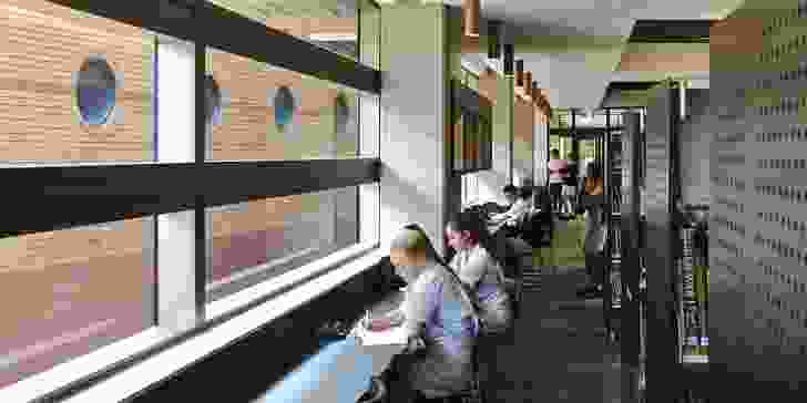 Students occupying window seats in the first-floor Resource Hub face the neighbouring heritage building.