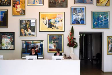 Reception is in simple white, with the artworks taking centre stage.