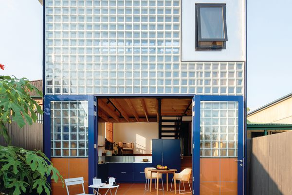 Charismatic new architecture brings the kitchen to ground level and introduces a neat mezzanine.