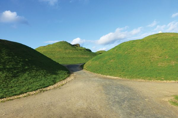 "Northumberlandia, or ""The Lady of the North,"" is an enormous land sculpture by Charles Jencks depicting a female figure made from the spoil of a former coalmine in Northumberland, UK."