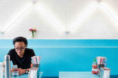 Fluoro lights are arranged in a zigzag pattern over pegboard.