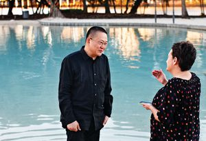 Wang Shu talks with Helen Norrie at Brisbane's artificial beach.