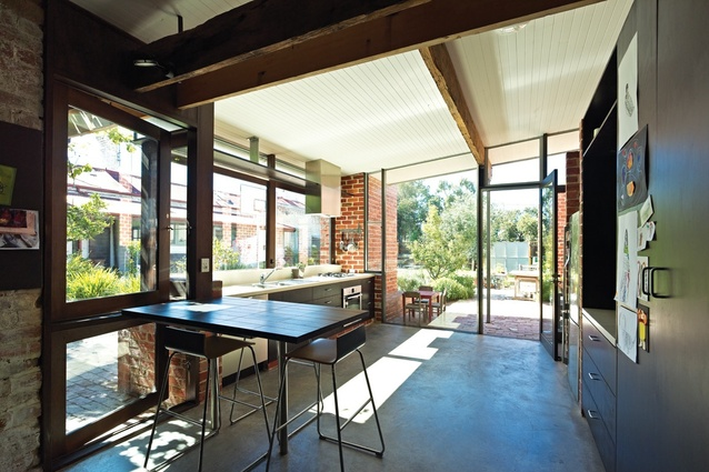 Brunswick East House: The kitchen extends out to the courtyard.