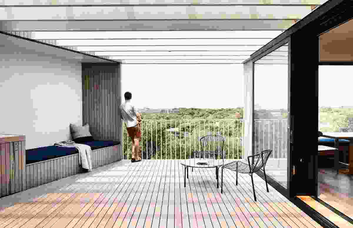 A partially covered outdoor balcony flows out from the kitchen and has focused views to the east and west.