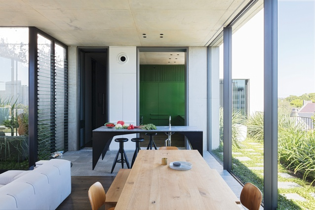 The living areas fill a new pavilion that joins two extant structures – the old lift enclosure and fire stair.
