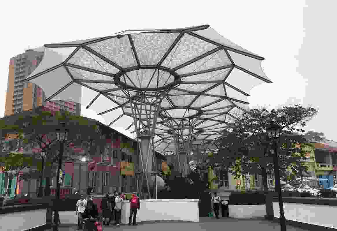 A large membrane roof structure at Singapore's Clarke Quay by Alsop Architects moderates the climate in the street below.