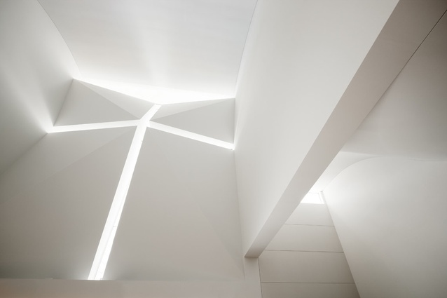 A slim glass crucifix above the foyer catches light in an ethereal way.