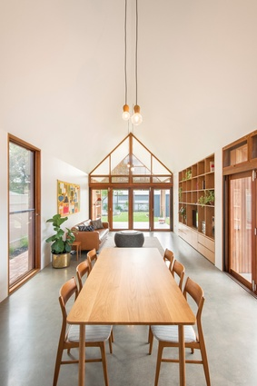 The extension's gable roof is used to maximum effect in the dining and living areas, where the ceiling height reaches a generous five metres. Artwork: Hanako Clulow.