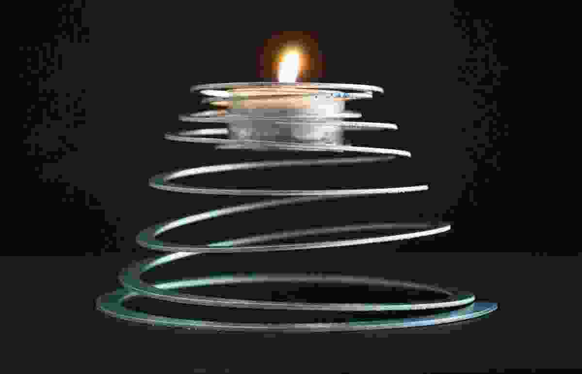 Spiralite supports a tealight on an extended aluminium coil.