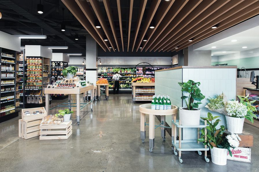 Mint-green tiles and oak timber give customers a fresh space to shop.