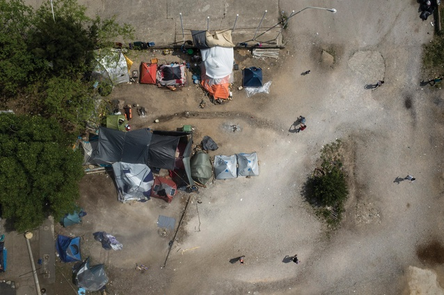 An aerial view of the BP service station refugee camp near Evzoni, Greece. Approximately 500 people live here in tents, abandoned buildings and the adjacent forest.