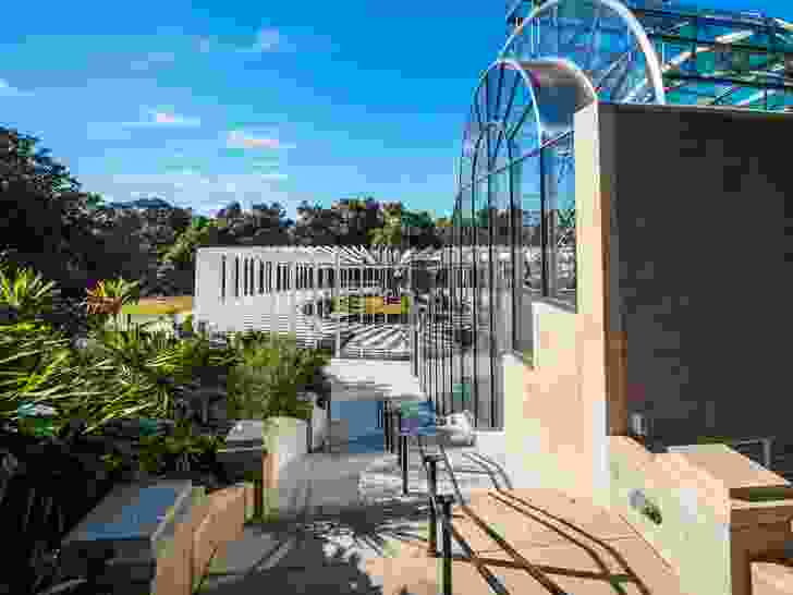The new Calyx structure designed by PTW Architects and McGregor Coxall in the Royal Botanic Gardens Sydney is set next to the Arc glasshouse designed by Ken Woolley.