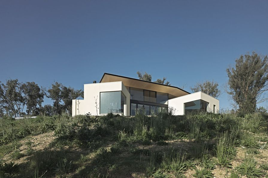 Built after the clients' home was lost to fire, Hillside Habitat reveals a love of nature.