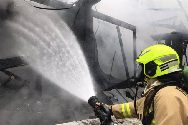 Firefighters respond to the blaze at Pirramimma in the Blue Mountains, designed by Peter Stutchbury Architecture.