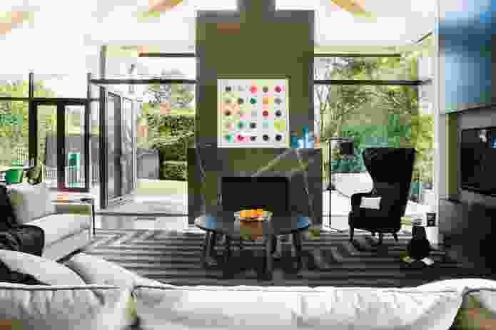 The living room is lit by the rear pavilion. Artwork: Damien Hirst.