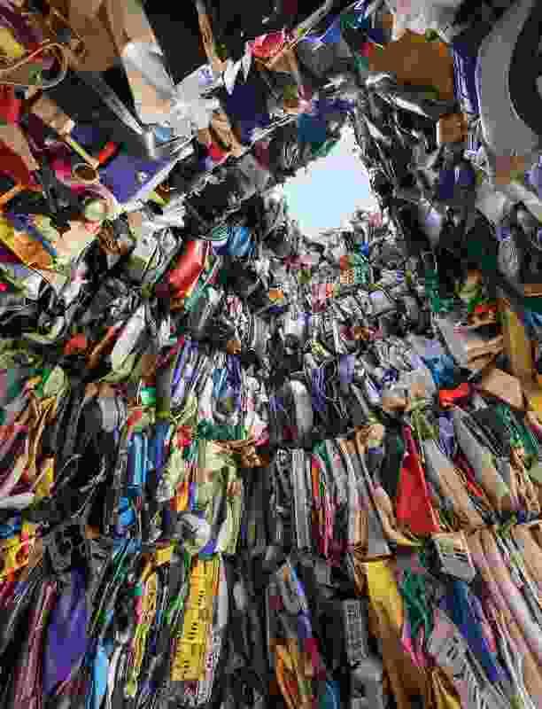 \A translucent geotextile skin encases the plastic waste.