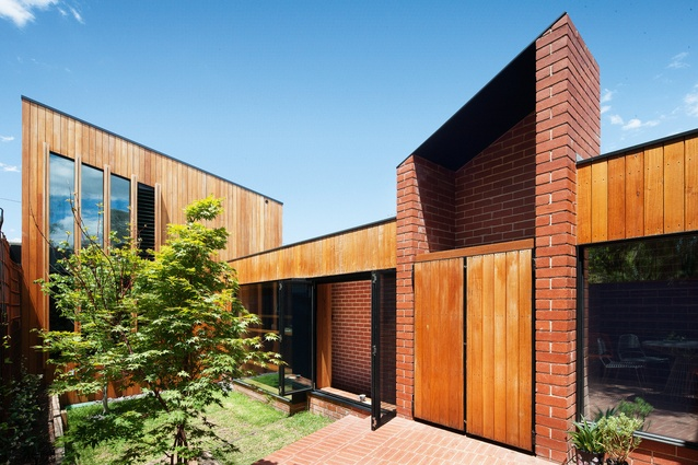 The extension's dynamic roof forms re-create in miniature the surrounding Carlton North roofscape.