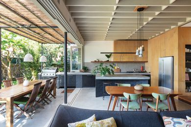 The kitchen and living area extend into the garden, making the most of the northern light.