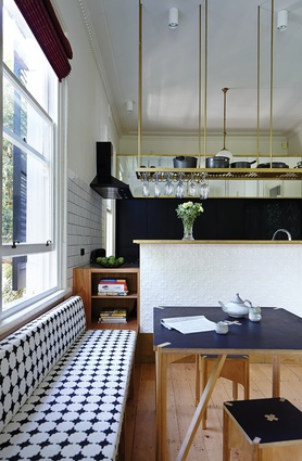 The kitchen includes furniture designed by the architects.