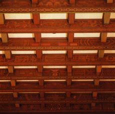 Winthrop Hall's hybridised references include ceiling rafters embellished with aboriginal motifs.