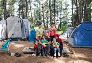 Abdisalam and his wife Rauha with their six children in a forest camp near the BP service station refugee camp of Evzoni, Greece. They left their home in Deir ez-Zor, Syria, in September 2012, and after spending years in Lebanon and Turkey they arrived in Greece two months before this photo was taken.