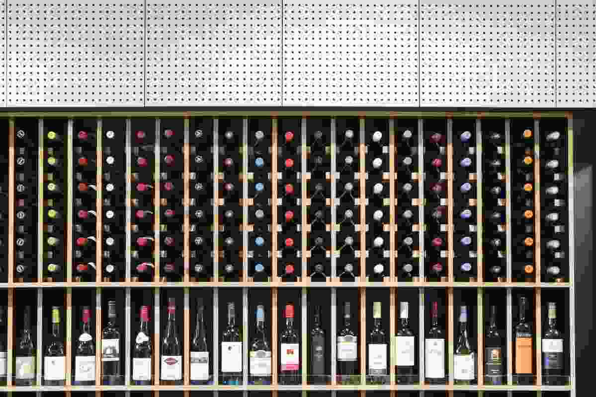 The design team wanted the liquor store to look like a bar. Shelving that showcases the wine collection helps to achieve this.
