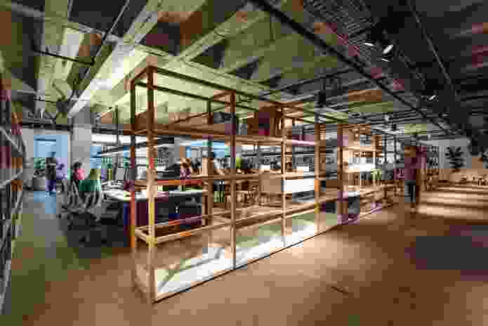 Custom oak shelving is used for storage and space partitioning.