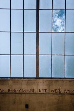 """An """"obscure and dramatic light"""" filters in through the original windows. Rollcall by Nicole Ellis, inscribed beneath, records the names of all the people who worked in the Powerhouse."""